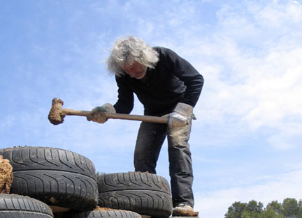 Architect Michael Reynolds Pounds Tires - From the film Garbage Warrior by Oliver Hodge