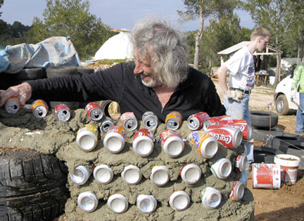 Architect Mike Reynolds works on a Can Wall - New Mexico - From the film Garbage Warrior by Oliver Hodge